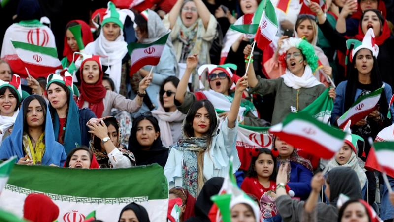 Iranian women attend Iran's World Cup Asian qualifier against Cambodia at the Azadi stadium in Tehran [Nazanin Tabatabaee/WANA via Reuters]