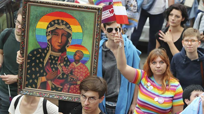In this Pride parade in August, the image of the Madonna and baby Jesus that has offended many Catholics was on display in Plock, Poland [File: Czarek Sokolowski/AP]