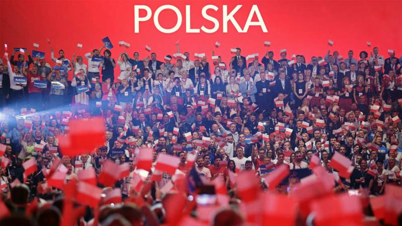 The ruling Law and Justice (PiS) party is set to win the election, but will it manage to secure an outright parliamentary majority? [Jakub Orzechowski/Agencja Gazeta/Reuters]