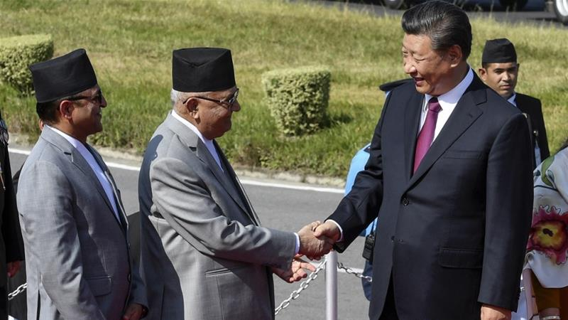 Prime Minister Oli (second left) welcomes Chinese President Xi Jinping to Kathmandu in October [File: Prakash Mathema/EPA]