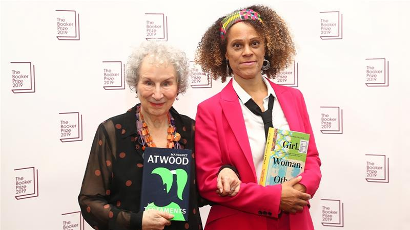 Margaret Atwood and Bernardine Evaristo after jointly winning the Booker Prize for Fiction 2019 at the Guildhall in London. The judges broke the rules to honour the two women. [Simon Dawson/Reuters]