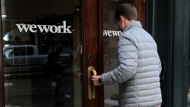 WeWork cancelled its initial public offering earlier in the year due to investor concerns over corporate governance and profitability issues [File: Carlo Allegri/Reuters]