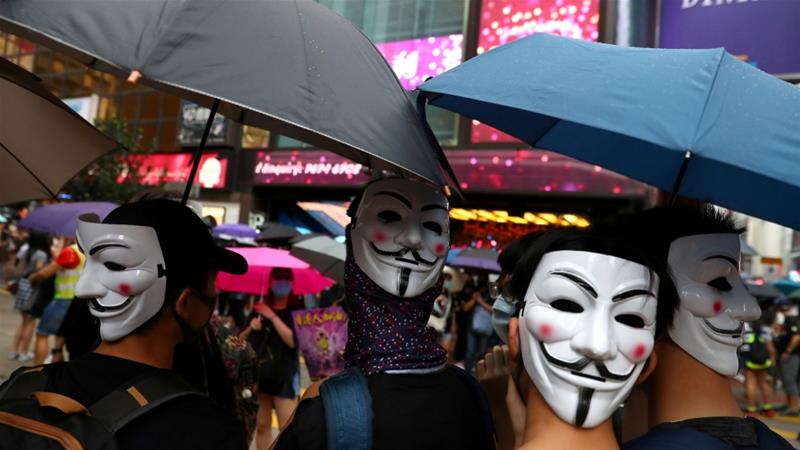 Anti-government protesters wear masks during a demonstration at Causeway Bay district, in Hong Kong, China October 6, 2019 [Athit Perawongmetha/Reuters]