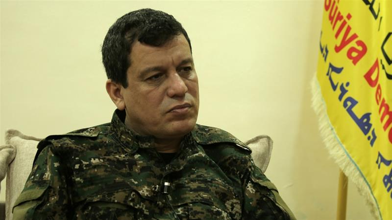Mazloum Abdi, SDF commander-in-chief, said Trump did not object to his group's deal with Syrian government [File: Rodi Said/Reuters]