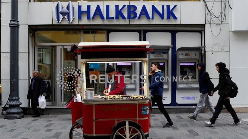 Halkbank, which is majority owned by the Turkish government, has become a casualty in the widening rift between the US and Turkey [File: Murad Sezer/Reuters]