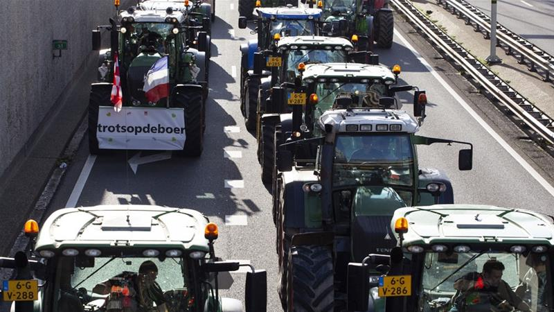 Thousands of Dutch farmers protest over the Netherlands' efforts to drastically reduce emissions of greenhouse gases [Peter de Jong/ Reuters]