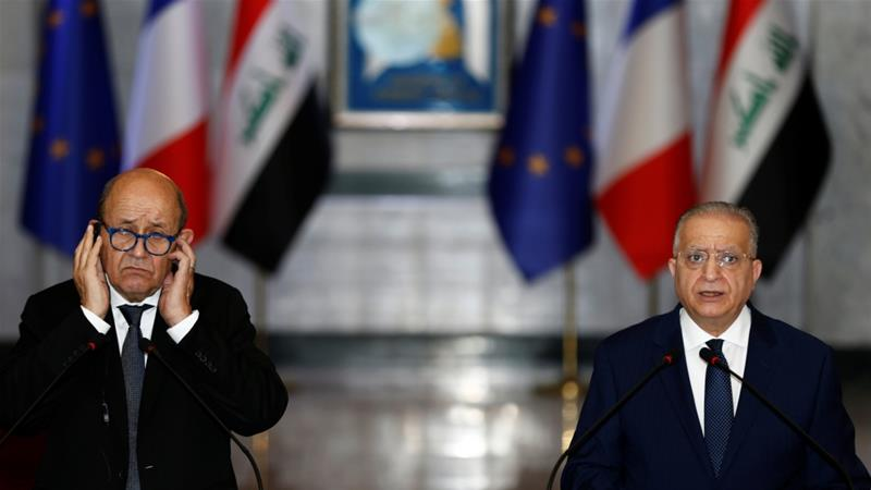 French Foreign Minister Jean-Yves Le Drian speaks with Iraqi Foreign Minister Mohamed Ali Alhakim at the Ministry of Foreign Affairs in Baghdad [Khalid al-Mousily/Reuters]