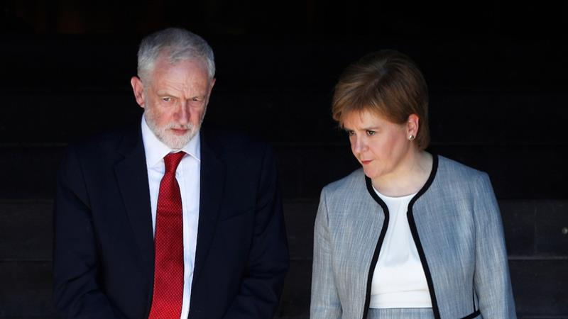 Labour Party leader Jeremy Corbyn and his SNP counterpart, Nicola Sturgeon, pledged to vote against the revised Brexit deal [File: Reuters]