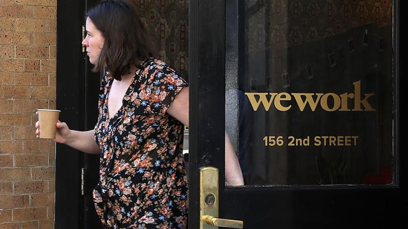 Just months ago, WeWork was valued around $47bn, but the ailing New York City-based company is now trying to cobble together a plan to save it [Justin Sullivan/Getty Images/AFP]