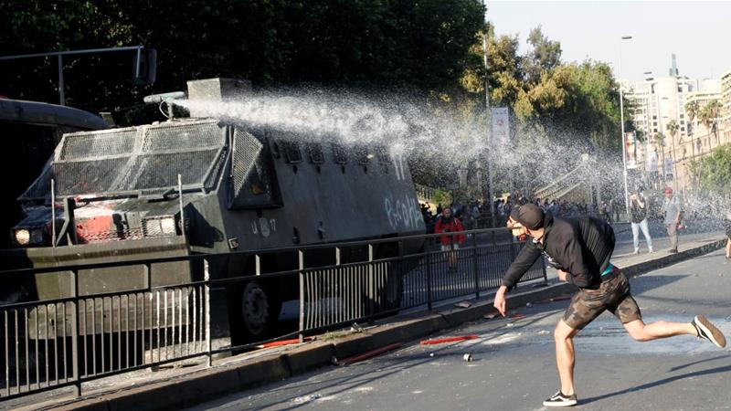 Chile's president declares state of emergency after riots over metro fare hike