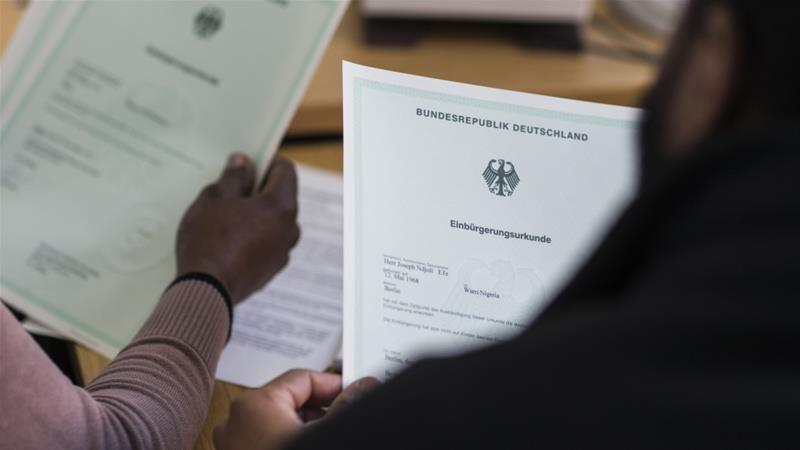 Among Nigeria's healthcare woes is the emigration of its physicians. Nine out of every ten doctors in Nigeria are seeking to leave the country and find work elsewhere - including the Nigerian doctor who is pictured here and signing paperwork to become a German citizen [Thomas Peter/Reuters]