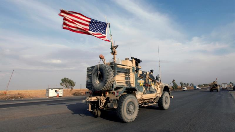 A convoy of US vehicles is seen after withdrawing from northern Syria, in Erbil, Iraq [Azad Lashkari/Reuters]