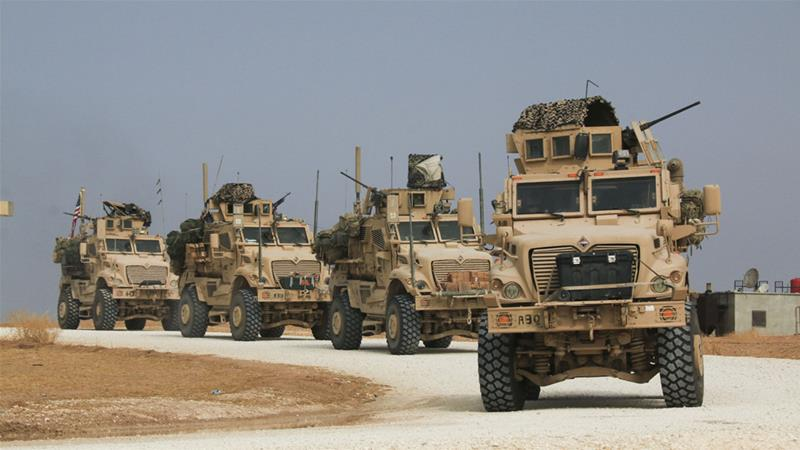 An American military convoy stops near the town of Tal Tamr, northern Syria, on Sunday [Baderkhan Ahmad/AP]