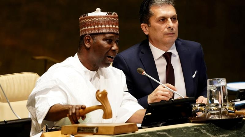 President of the UNGA, Tijjani Muhammad-Bande, bangs the gavel to open the 74th session of the United Nations General Assembly in New York [Lucas Jackson/Reuters]