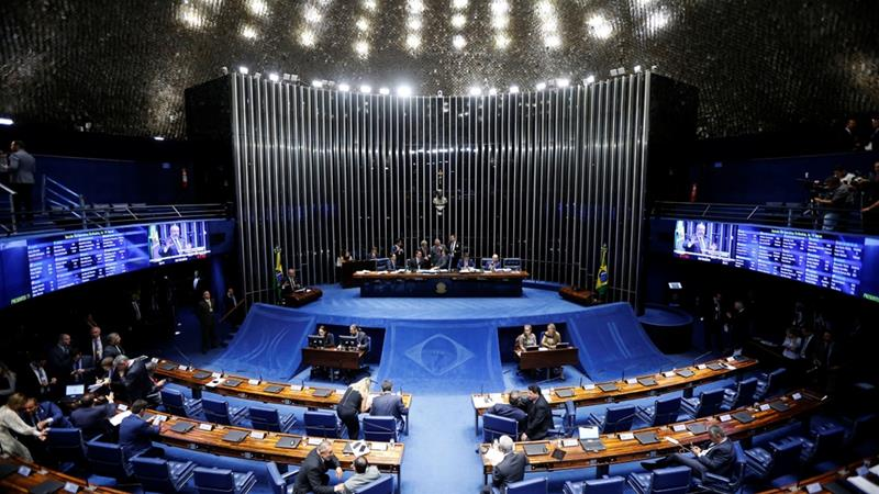 The Senate voted 60-19 on Tuesday to adopt changes for civil servants and private-sector workers [Adriano Machado/Reuters]