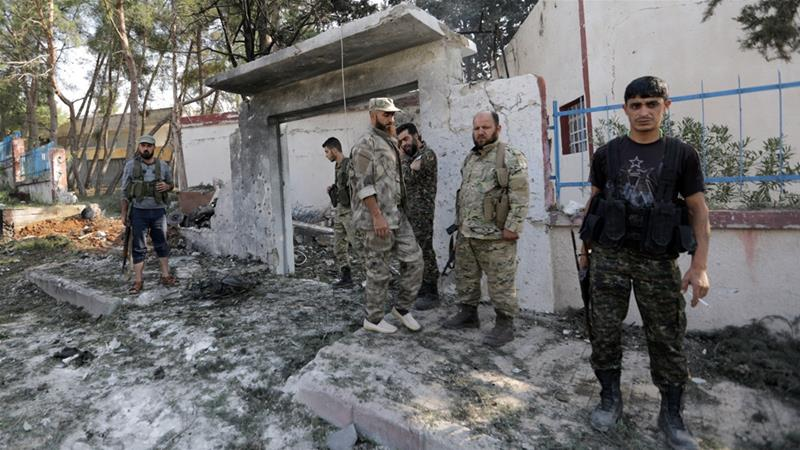 A car exploded in front of the headquarters of a Turkey-backed Syrian rebel militia in the town of Tal Abyad. [Khalil Ashawi/Reuters]