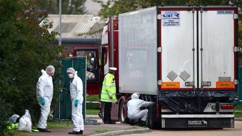 Police are seen at the scene where bodies were discovered in a lorry container, in Grays, Essex [Hannah McKay/Reuters]