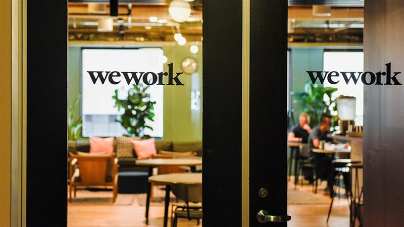 SoftBank to write down minimum $5 bln for WeWork, other losses
