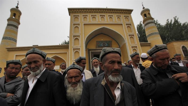 Muslim men of the Uighur ethnic group leaving the Id Kah Mosque after Friday prayers in Kashgar, Xinjiang Uighur Autonomous Region, China [File: Hwee Young/EPA]
