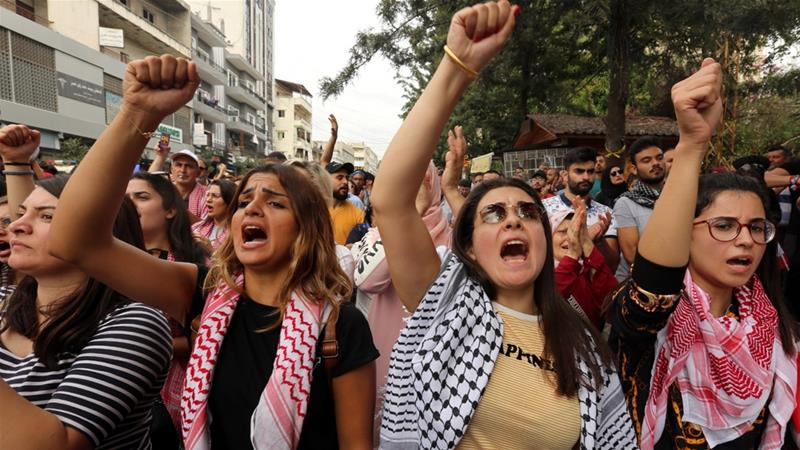 Demonstrators shout slogans during an anti-government protest in Nabatieh, Lebanon, in a scene that could be from any number of current global hot spots [Aziz Taher/Reuters]