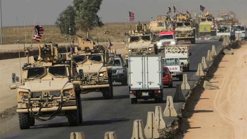 A convoy of US vehicles withdraws from Syria while more forces will be deployed to protect Syrian oilfields [Ari Jalal/Reuters]