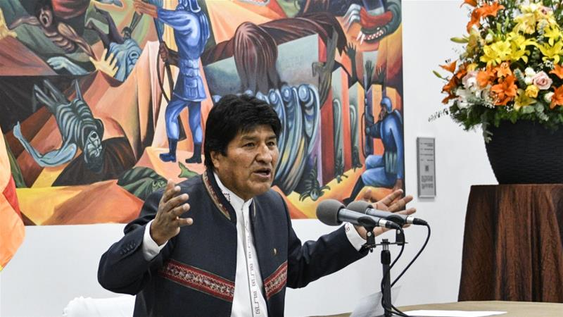 Morales needed more than 50 percent of the vote to win, or 40 percent plus a 10-point lead to avoid a second round of voting in December [Aizar Raldes/AFP]