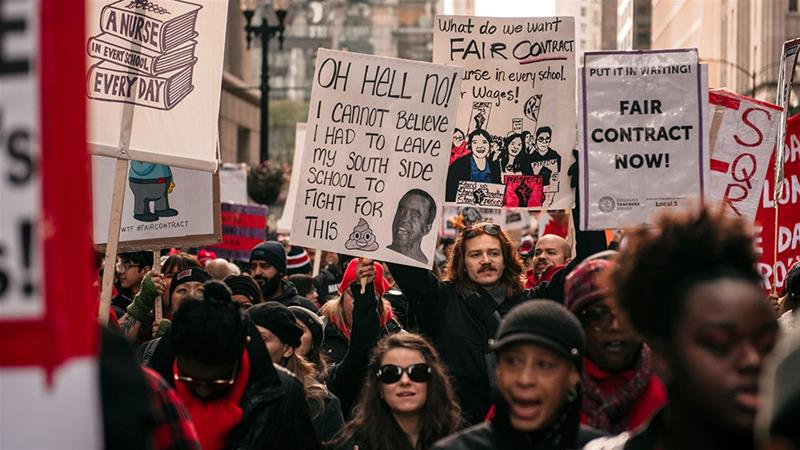 Thousands of demonstrators take to the streets, stopping traffic and circling City Hall in a show support for the ongoing teachers strike [Scott Heins/Getty Images/AFP]