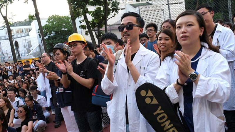 Medical workers in Hong Kong rally against police violence