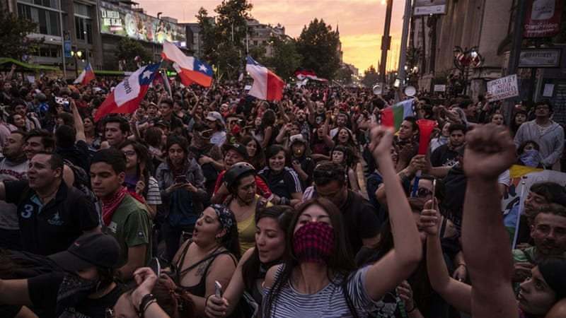 Chile's Pinera calls on ministers to resign amid protests