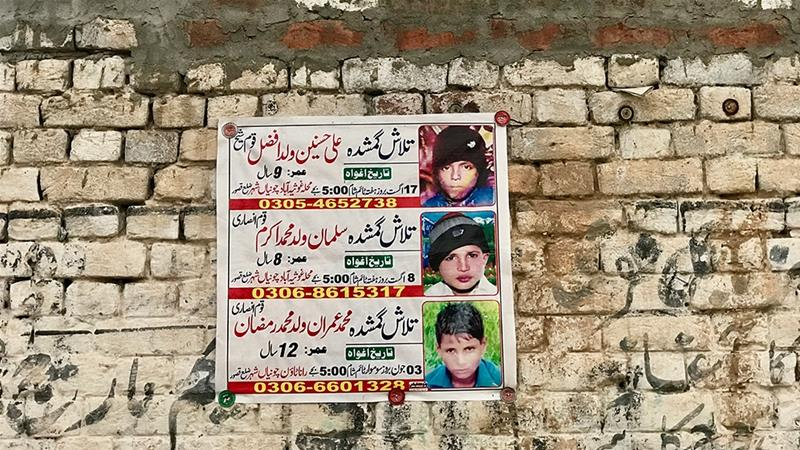 Posters with photos of missing children are still pasted on walls around Chunian, Pakistan, where four boys were found dead after being kidnapped and raped [Zehra Abid/Al Jazeera]