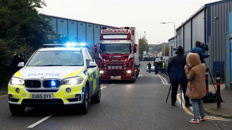 The container lorry has now been moved away from the site where the bodies were found [Hannah McKay/Reuters]