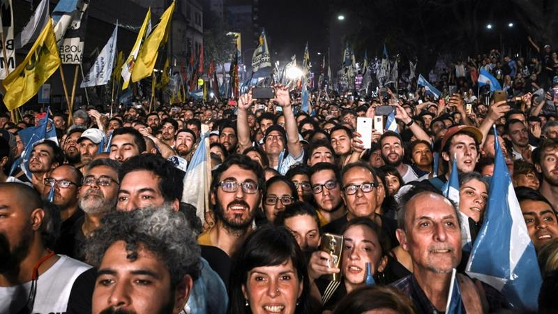 Supporters celebrated on the streets after Alberto Fernandez and Christina Fernandez de Kirchner were elected on Sunday [Magali Druscovich/Reuters]
