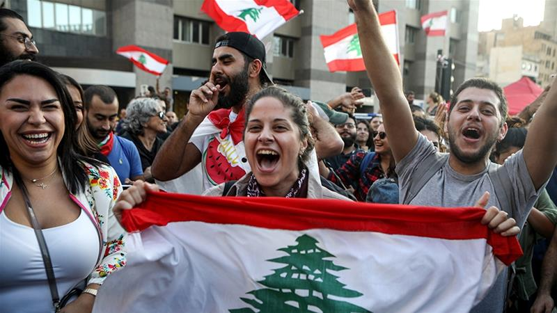 Lebanese protesters celebrate Hariri resignation, but want more