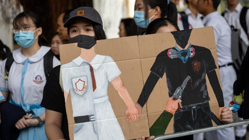 Hong Kong protester shot by police charged with assault, rioting