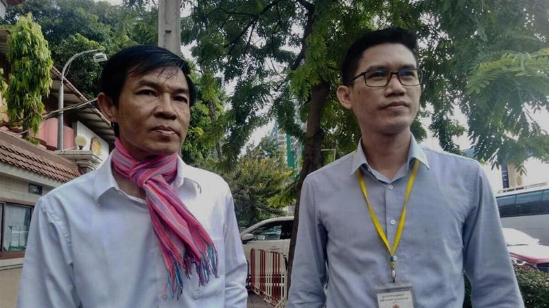 Uon Chhin and Yeang Sothearin outside the court in Phnom Penh on Thursday. The judge announced a new investigation into allegations of spying, further extending a case critics say should never have made it to court [Yon Sineat/Al Jazeera]