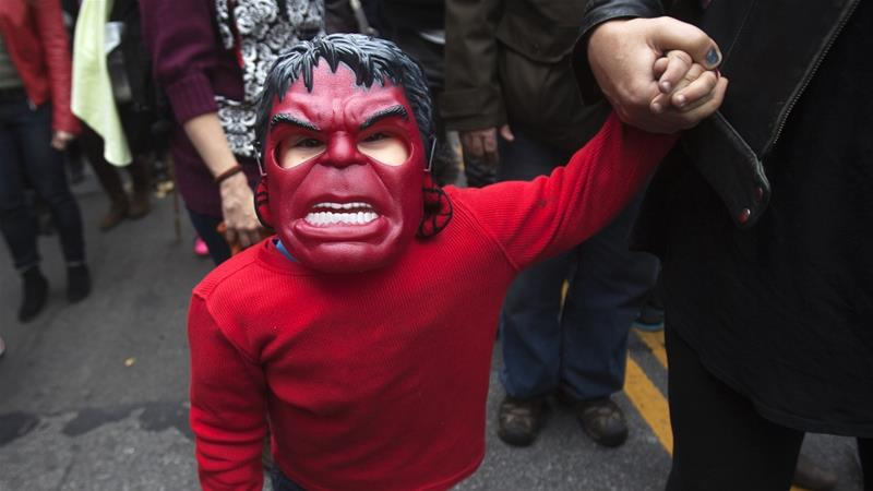 A child in a costume takes part in the 24th Annual Greenwich Village Children Halloween Parade in the Manhattan borough of New York on October 31, 2014 [File: Carlo Allegri/Reuters]