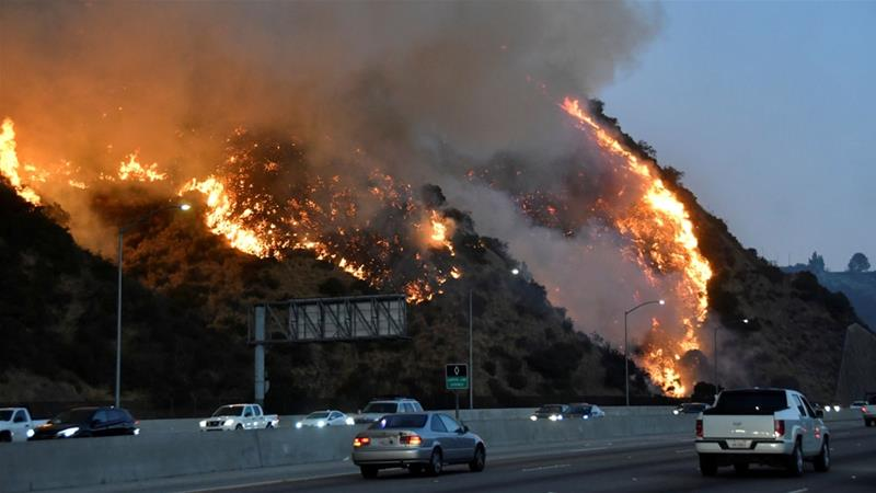 High winds threaten to make worse a wildfire near Los Angeles [Gene Blevins/Reuters]