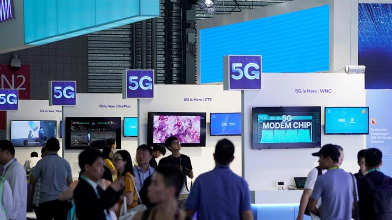 China is set to become the world's largest provider of 5G mobile phone services as some telecoms operators in the United States and South Korea have begun introducing the technology in their home countries [File: Aly Song/Reuters]