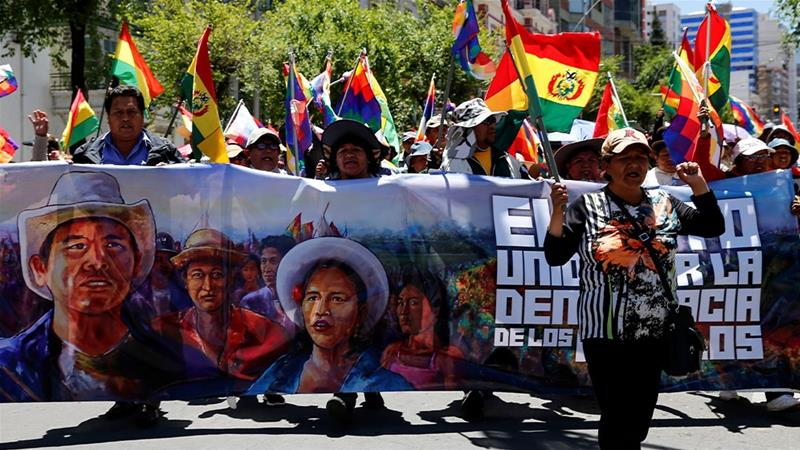 Supporters of Bolivia's President Evo Morales in a march in La Paz, Bolivia [David Mercado/Reuters]