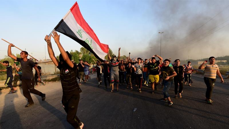 Iraq blames 'malicious' hands as toll from unrest tops 100