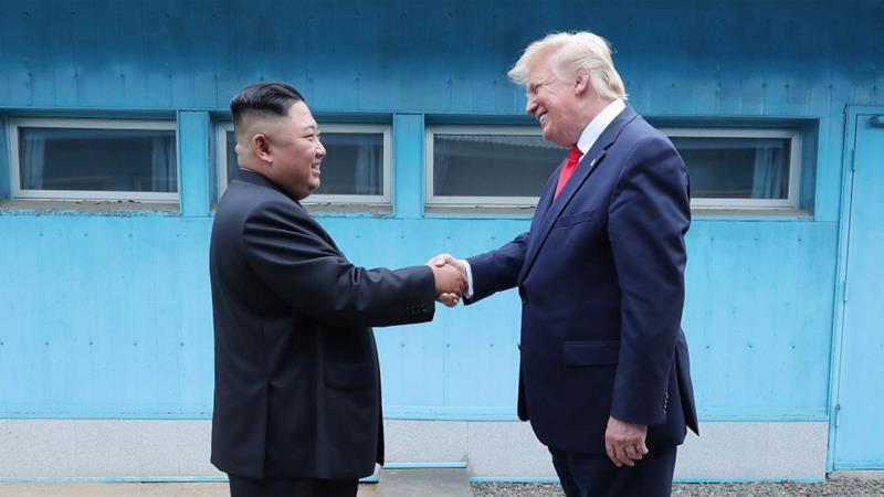 North Korean leader Kim Jong Un shakes hands with President Donald Trump at the demilitarized zone in June 2019 [File: KCNA via Reuters]