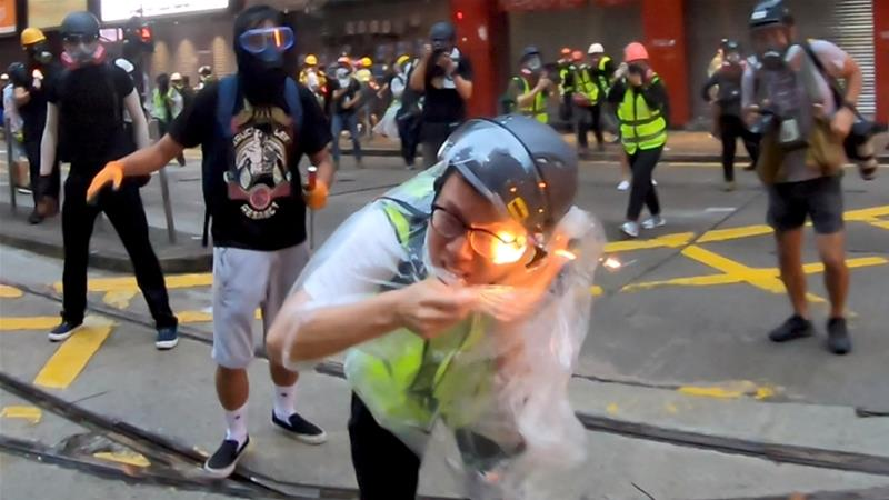 Flames are seen on a journalist after he was hit with a petrol bomb during a protest in Wan Chai, Hong Kong [Angus Wong Chun Yiu/Reuters]