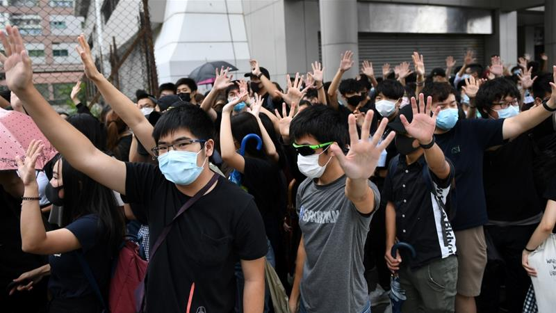 Hong Kong's leader defends ban on face masks