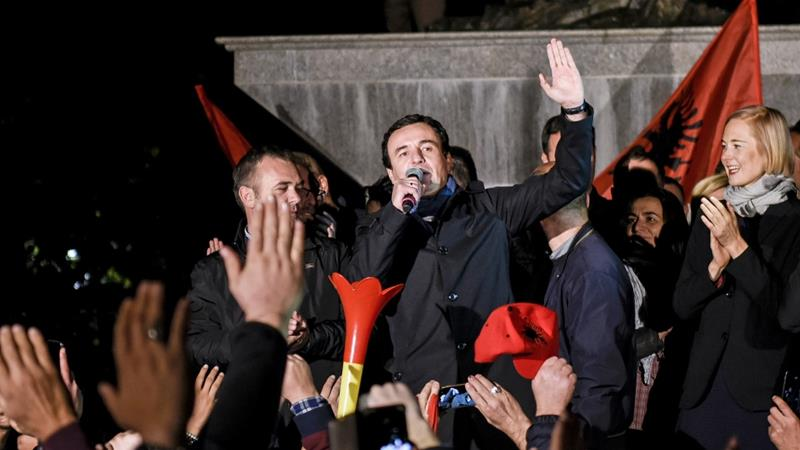 The leader of the Vetevendosje Party and prime ministerial candidate Albin Kurti (C) addresses his supporters as they celebrate their victory in Pristina on Sunday night [Armend Nimani/AFP]