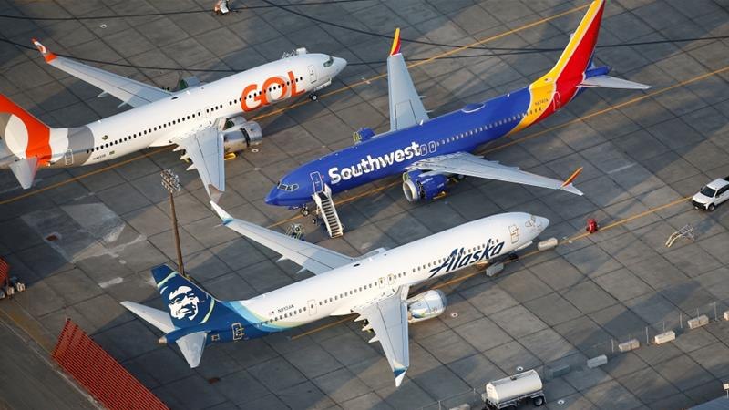 Boeing 737 MAX aircraft belonging to Gol Airlines, Southwest Airlines and Alaska Airlines sit on the tarmac at Boeing facilities within the Grant County International Airport in Moses Lake in the US state of Washington [File: Lindsey Wasson/Reuters]