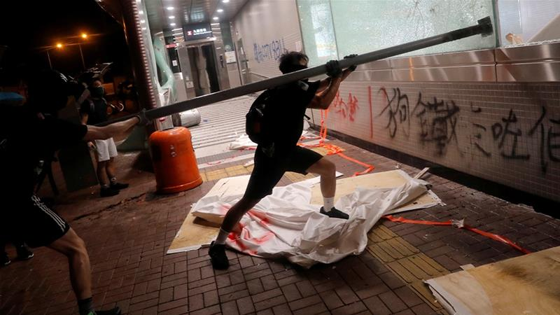 Democracy protesters have stepped up attacks on property and metro stations as the Hong Kong demonstrations enter their fourth month. [Susana Vera/Reuters]