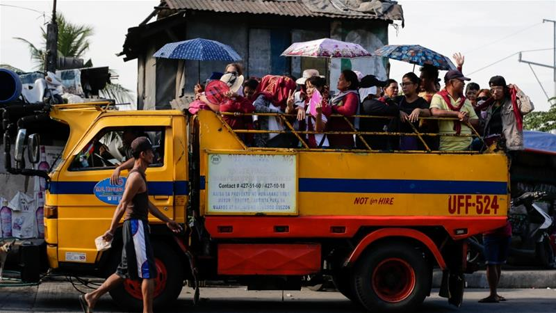 Despite safety concerns, many Filipinos with limited financial means ride on cargo trucks because they are typically offered for free [File: Mark R Cristino/EPA]
