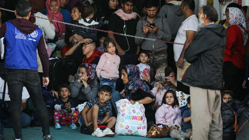Greece passes tough asylum laws as Aegean refugee camps at breaking point