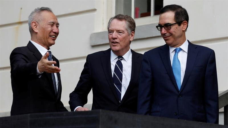 China said its Vice Premier Liu He, far left, spoke to US Treasury Secretary Steven Mnuchin, far right, and US Trade Representative Robert Lighthizer in a phone call on Tuesday [File: Yuri Gripas/Reuters]
