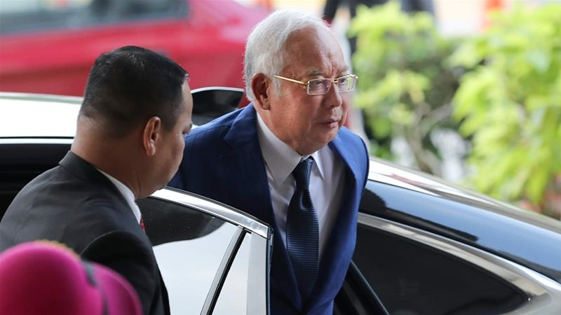 Former Malaysian Prime Minister Najib Razak will find out on Monday on whether he has to enter his defence in the first of a series of trials into state fund 1MDB. He has denied wrongdoing. [File: Vincent Thian/AP Photo]